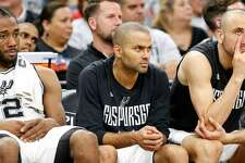 San Antonio Spurs' Kawhi Leonard, Tony Parker, and Manu Ginobili sit dejected during second half action of Game 1 in the Western Conference semifinals against the Houston Rockets May 1, 2017. Parker should have ended his career in San Antonio.
