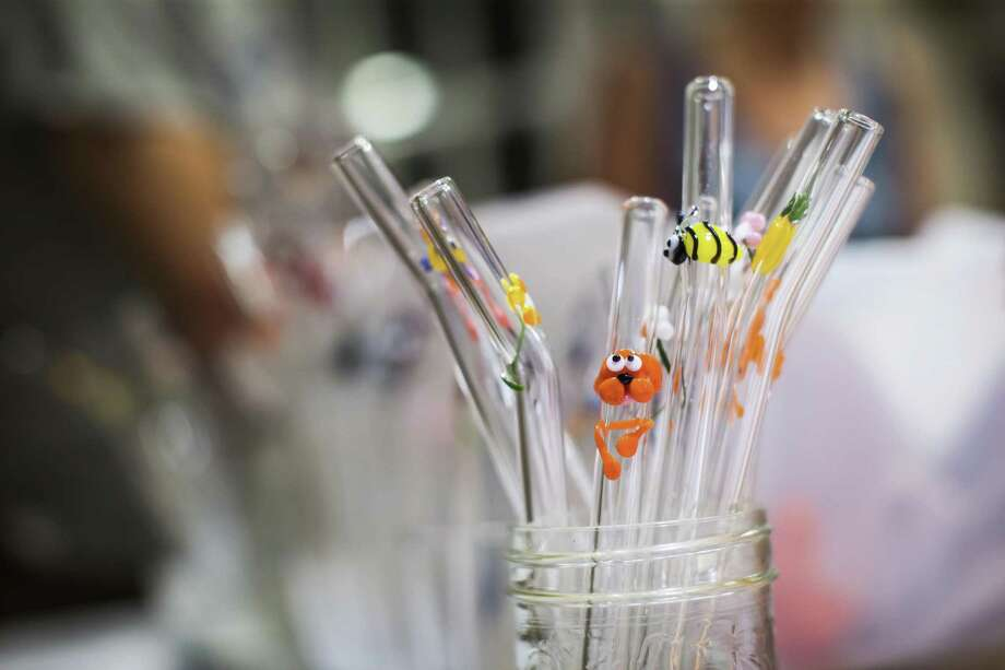 In this Wednesday, July 11, 2018, photo, glass straws are seen at Aimee Promislow and Fred Tischler's home where they operate their glass straw company, Glass Sipper, in Vancouver. (Darryl Dyck/The Canadian Press via AP) Photo: DARRYL DYCK, SUB / Associated Press / The Canadian Press