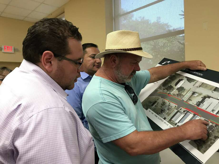 FILE PHOTO—Larry Reiland, who owns a small all-natural pet store business, Petz, at 211 Liberty St. reviews final design plans at the The Texas Department of Transportation's town hall meeting August 2017 in Montgomery. Photo: Meagan Ellsworth / Meagan Ellsworth