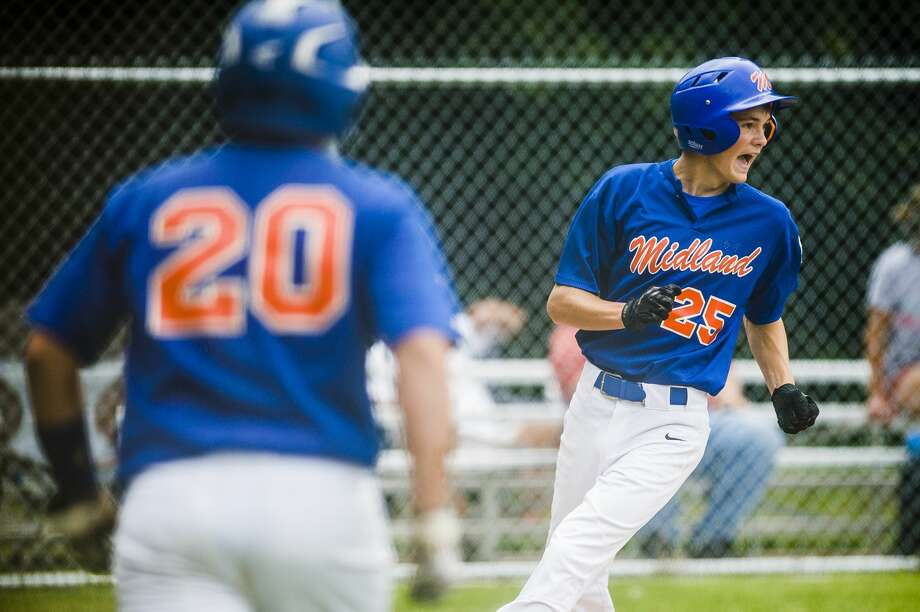 Midland Northeast's John Szajenko scores a run during a game against Bullock Creek on Thursday, July 12, 2018 at Larkin Township Park. (Katy Kildee/kkildee@mdn.net) Photo: (Katy Kildee/kkildee@mdn.net)
