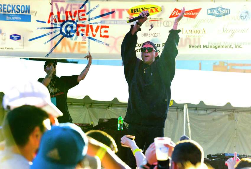 Rap Artist Sammy Adams entertains the crowd gathered for the Alive@Five concert series on July 12, 2018. Several thousand concert goers filled Columbus Park in Stamford, Connecticut to listen to Adams mixing pop hooks and suburban party rap style along with Reggae-soaked R&B singer/songwriter Sean Kingston.