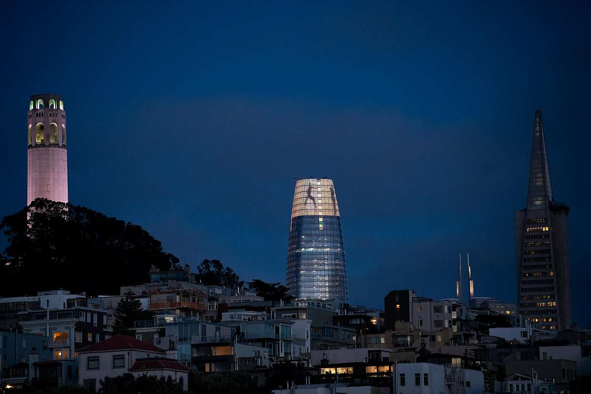 Salesforce Tower now punctuates the San Francisco skyline. Figures dance across the crown of Salesforce Tower on May 17, 2018, in San Francisco, as part of a light installation by artist Jim Campbell.