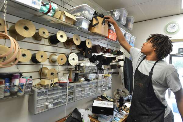 At Norwalk Shoe Repair, Norwalk High School student Kevin Frank keeps the store organized during the Mayors Summer Youth Employment Program on Thursday July 12, 2018 in Norwalk Conn.