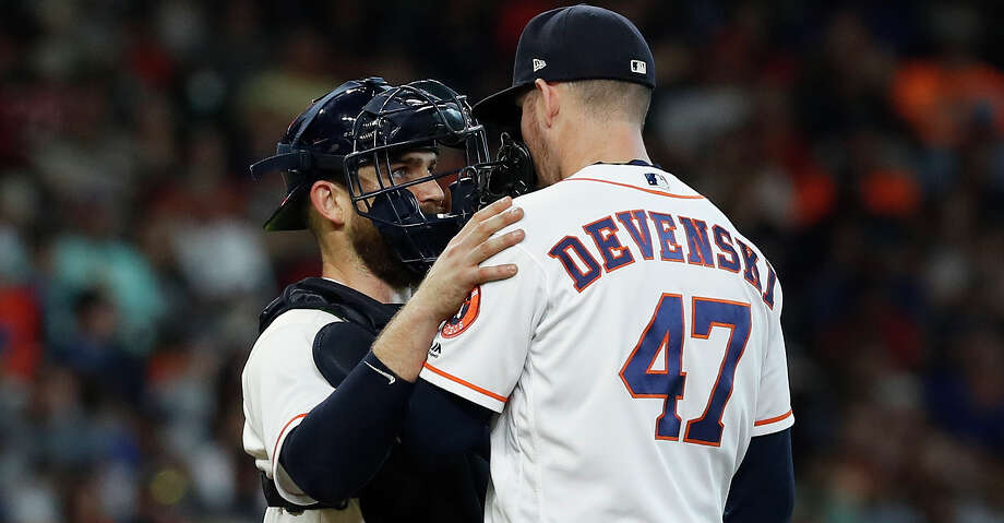 Houston Astros catcher Max Stassi (12) talks with relief pitcher Chris Devenski (47) during the eighth inning of an MLB game at Minute Maid Park, Thursday, July 12, 2018, in Houston. ( Karen Warren  / Houston Chronicle ) Photo: Karen Warren/Houston Chronicle / © 2018 Houston Chronicle