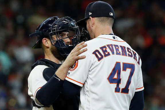 Houston Astros catcher Max Stassi (12) talks with relief pitcher Chris Devenski (47) during the eighth inning of an MLB game at Minute Maid Park, Thursday, July 12, 2018, in Houston. ( Karen Warren  / Houston Chronicle )