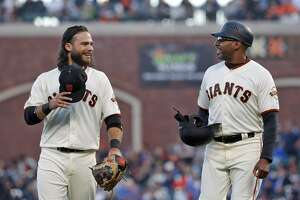 Brandon Crawford (35) chats with first base coach Jose Alguacil between inning as the San Francisco Giants played the Chicago Cubs at AT&T Park in San Francisco, Calif., on Tuesday, July 10, 2018.