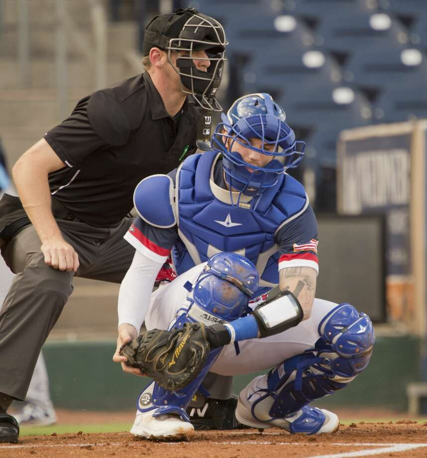 RockHounds' starting catcher Jonah Heim takes a pitch 07/12/18 as umpire Kyle McGrady watches the zone against the Corpus Christi Hooks at Security Bank Ballpark. Tim Fischer/Reporter-Telegram Photo: Tim Fischer/Midland Reporter-Telegram