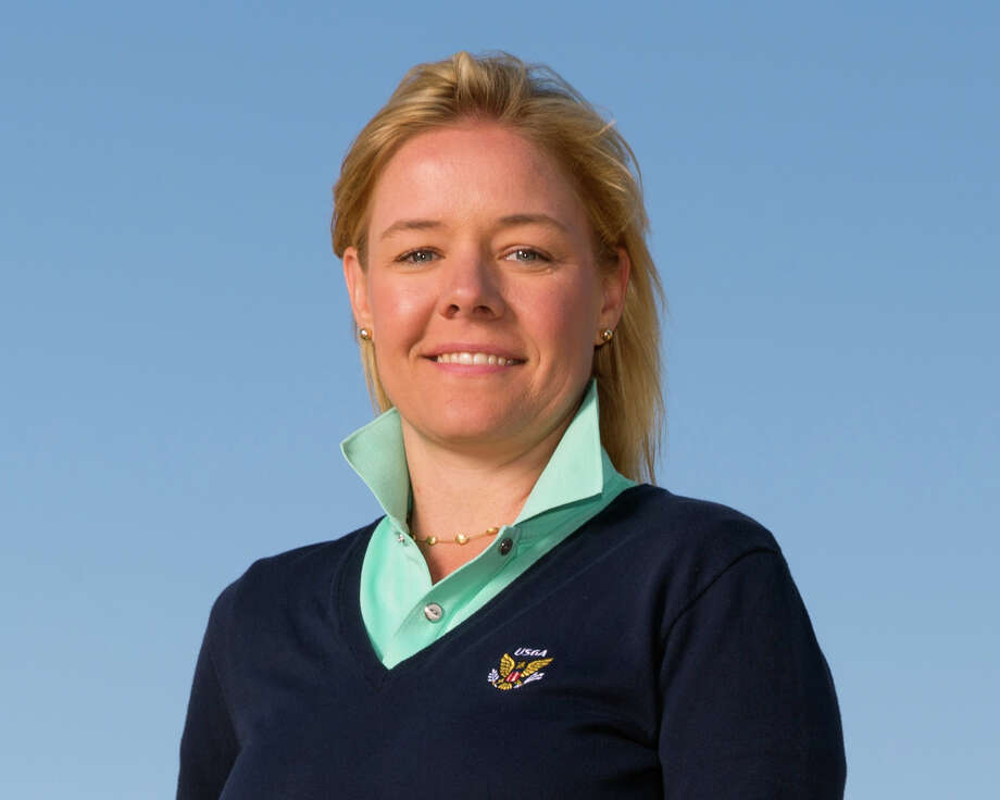 This June 20, 2015, photo provided by the USGA shows Sarah Hirshland during the third round of the 2015 U.S. Open golf tournament at Chambers Bay in University Place, Wash. The U.S. Olympic Committee has hired Sarah Hirshland as its CEO, placing the executive at the U.S. Golf Association in charge of stabilizing an organization that has been hammered by sex-abuse scandals spanning several Olympic sports. (Darren Carroll/USGA via AP) Photo: Darren Carroll / USGA/Darren Carroll