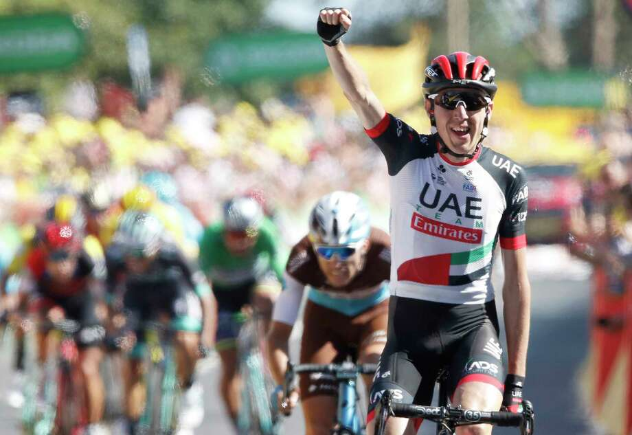 Ireland's Daniel Martin celebrates as he crosses the finish line to win the sixth stage of the Tour de France cycling race over 181 kilometers (112.5 miles) with start in Brest and finish in Mur-de-Bretagne Guerledan, France, Thursday, July 12, 2018. (AP Photo/Christophe Ena ) Photo: Christophe Ena / Copyright 2018 The Associated Press. All rights reserved