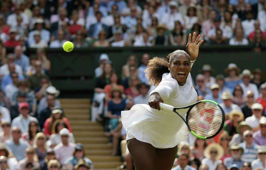 Serena Williams of the United States returns the ball to Germany's Julia Gorges during their women's singles semifinals match at the Wimbledon Tennis Championships, in London, Thursday July 12, 2018.(AP Photo/Tim Ireland) Photo: Tim Ireland / Copyright 2018 The Associated Press. All rights reserved.