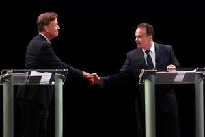 Ned Lamont, left, shakes hands with Bridgeport Mayor Joe Ganim before the start of the first Democratic debate for governor at the Shubert Theater in New Have on Thursday.