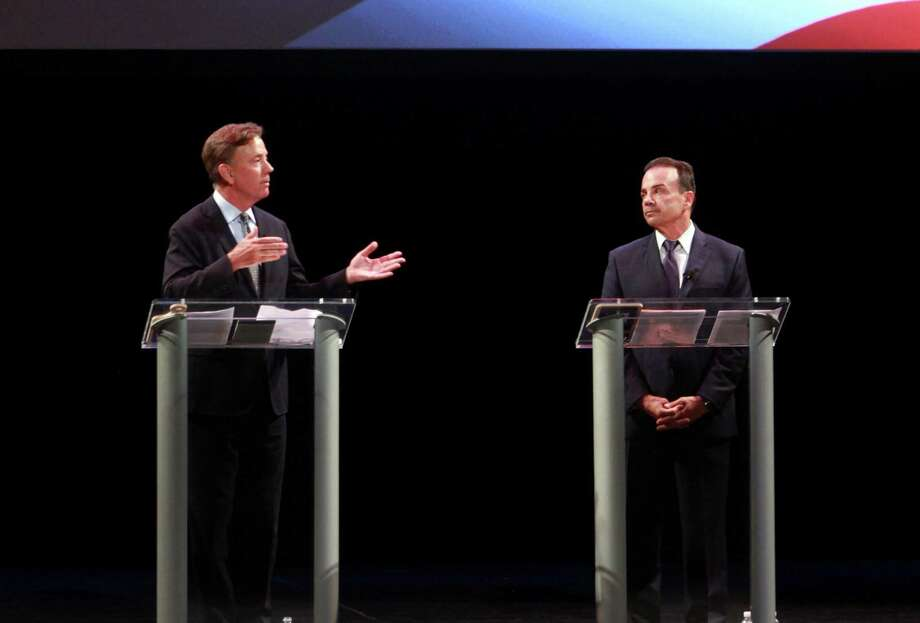 Ned Lamont, left, speaks as he takes part with Bridgeport Mayor Joe Ganim in the first Democratic debate for governor at the Shubert Theatre in New Haven Thursday. Photo: Christian Abraham / Hearst Connecticut Media / Connecticut Post