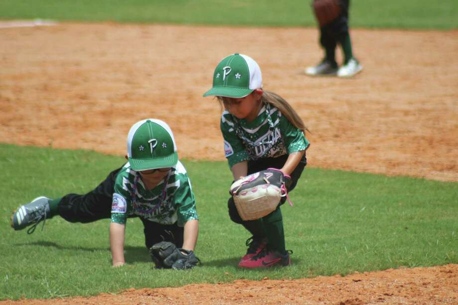 Two Pasadena defenders converge on a ground ball during Thursday afternoon's Shetland 4U World Series taking place in Deer Park. The World Series continues Friday morning. Photo: Robert Avery
