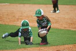 Two Pasadena defenders converge on a ground ball during Thursday afternoon's Shetland 4U World Series taking place in Deer Park. The World Series continues Friday morning.