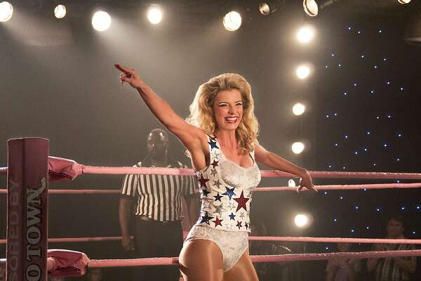 "This image released by Netflix shows Betty Gilpin in a scene from ""GLOW."" Gilpin was nominated Thursday for an Emmy for outstanding supporting actress in a comedy series. The 70th Emmy Awards will be held on Monday, Sept. 17. (Erica Parise/Netflix via AP)"