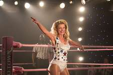 """This image released by Netflix shows Betty Gilpin in a scene from """"GLOW."""" Gilpin was nominated Thursday for an Emmy for outstanding supporting actress in a comedy series. The 70th Emmy Awards will be held on Monday, Sept. 17. (Erica Parise/Netflix via AP)"""