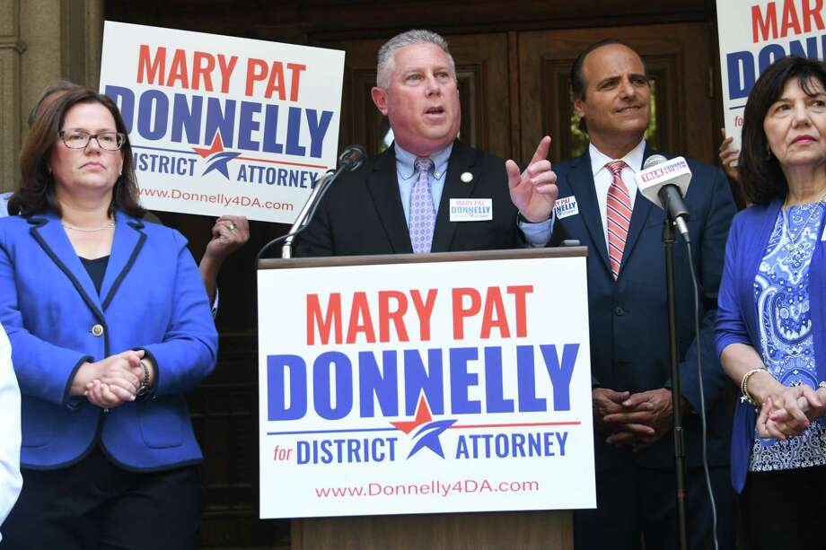 Assemblyman John McDonald lll speaks before Mary Pat Donnelly, left, Democratic candidate for Rensselaer County DA, makes an announcement to run for Rensselaer County District Attorney at the Rensselaer County Court House on Thursday, July 12, 2018 in Troy, N.Y. (Lori Van Buren/Times Union) Photo: Lori Van Buren / 20044322A