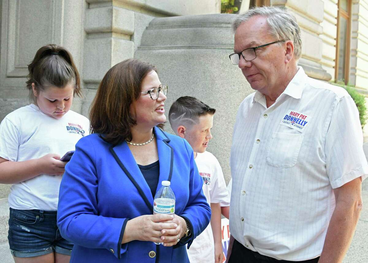 Mary Pat Donnelly, Democratic candidate for Rensselaer County DA, talks to retired judge Tom Keefe after she made an announcement to run for Rensselaer County District Attorney at the Rensselaer County Court House on Thursday, July 12, 2018 in Troy, N.Y. The two have known each other for a long time. (Lori Van Buren/Times Union)