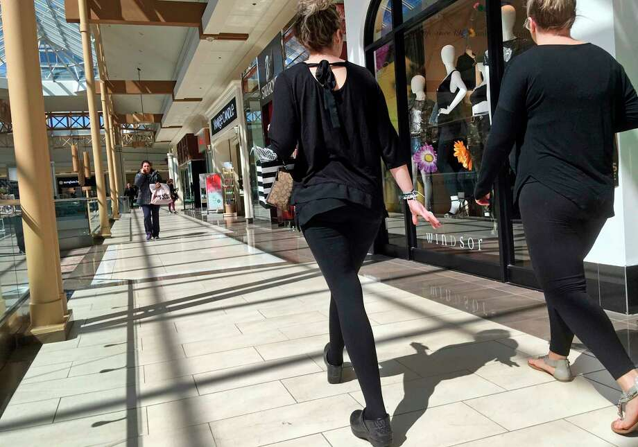FILE- In this April 9, 2018, file photo, shoppers walk in a mall in Salem, N.H. As Amazon gears up for its Prime Day promotion, other big-name retailers like Macy's and eBay are launching deals and sales of their own. But small businesses, including those that don't sell much online, shouldn't sit on the sidelines. (AP Photo/Elise Amendola, File) Photo: Elise Amendola / Copyright 2018 The Associated Press. All rights reserved.