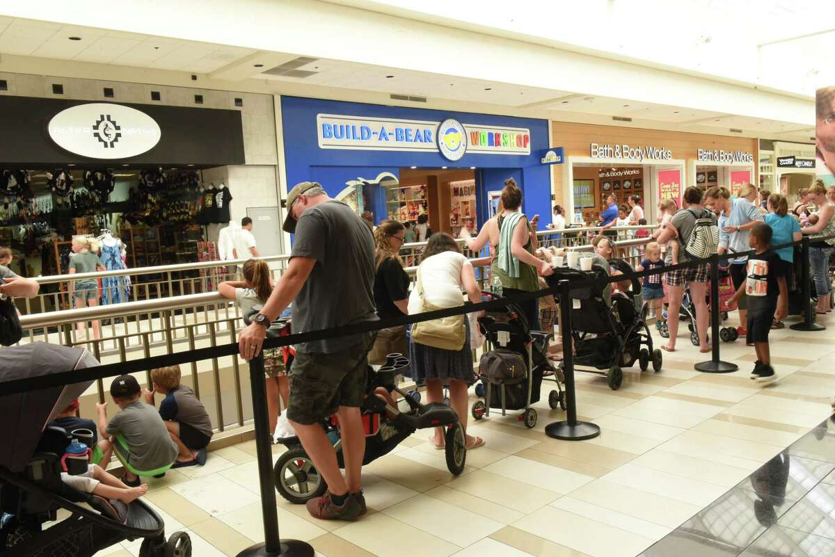 People wait for hours in a long line to enter the Build-A-Bear Workshop store at Crossgates Mall on Thursday, July 12, 2018 in Guilderland, N.Y.