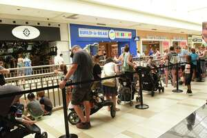 """People wait for hours in a long line to enter the Build-A-Bear Workshop store at Crossgates Mall on Thursday, July 12, 2018 in Guilderland, N.Y. Today was the store's """"pay-your-age"""" promotion. (Lori Van Buren/Times Union)"""