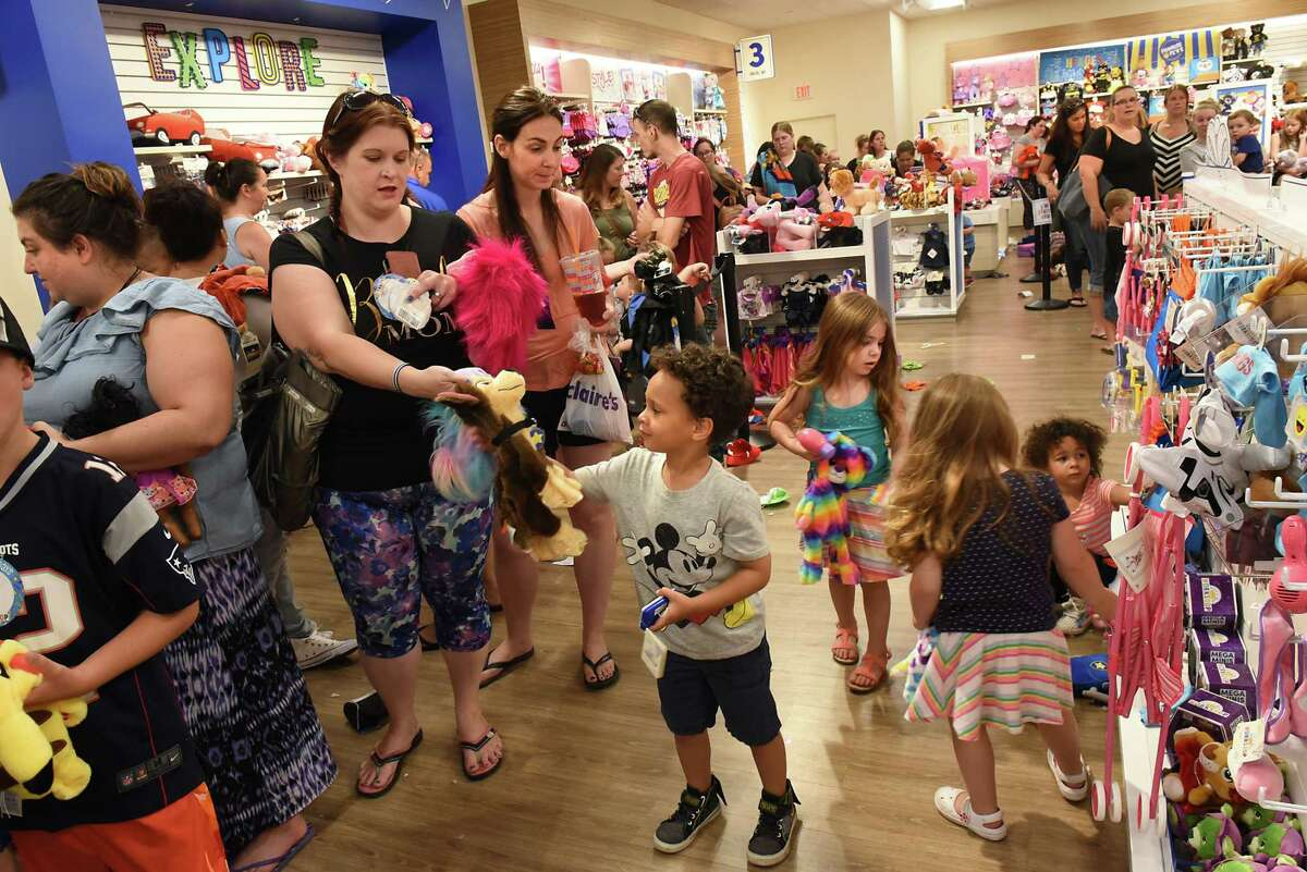 Children and parents wait in line at the Build-A-Bear Workshop at Crossgates Mall on Thursday, July 12, 2018 in Guilderland, N.Y.