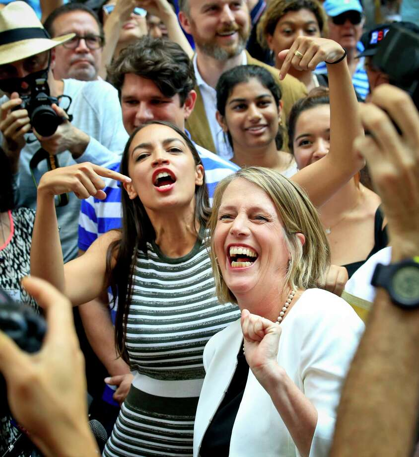 Alexandria Ocasio-Cortez, center, the surprise winner in the congressional race who unseated 20-year incumbent Joe Crowley in New York's Congressional District 14, points to Zephyr Teachout while endorsing her candidacy for Attorney General during a press conference, Thursday, July 12, 2018, in New York. (AP Photo/Bebeto Matthews) Photo: Bebeto Matthews / Copyright 2018 The Associated Press. All rights reserved.