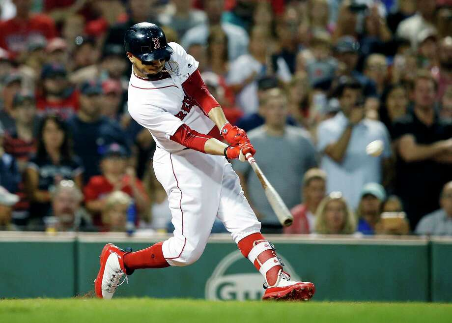 Boston Red Sox's Mookie Betts hits a grand slam during the fourth inning against the Toronto Blue Jays in a baseball game in Boston, Thursday, July 12, 2018. (AP Photo/Michael Dwyer) Photo: Michael Dwyer / Copyright 2018 The Associated Press. All rights reserved