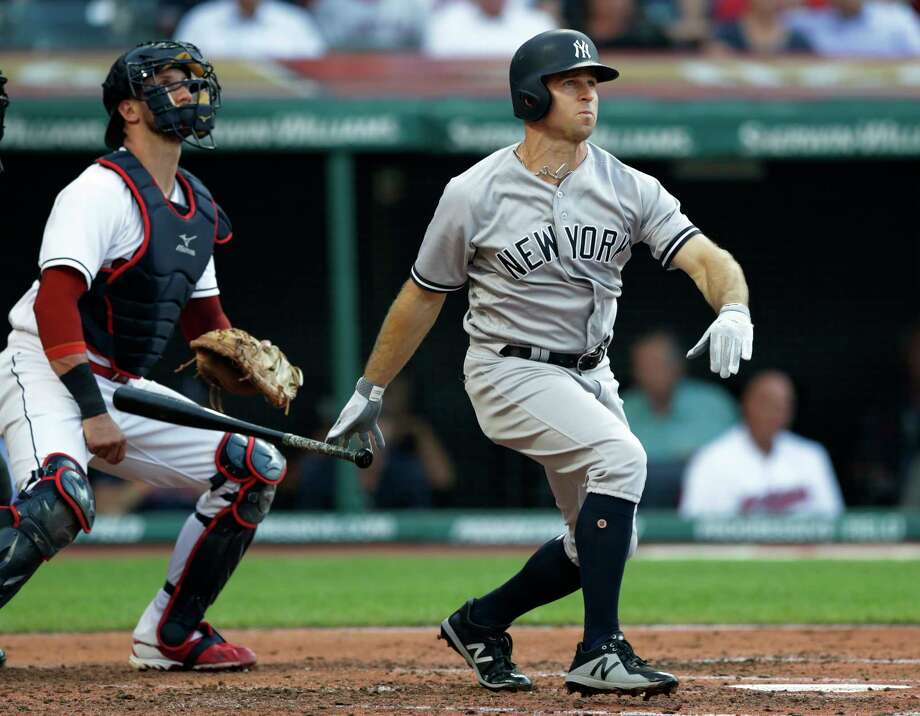 New York Yankees' Brett Gardner watches his two-run home run off Cleveland Indians starting pitcher Corey Kluber during the third inning of a baseball game Thursday, July 12, 2018, in Cleveland. Indians catcher Yan Gomes is at left. (AP Photo/Tony Dejak) Photo: Tony Dejak / Copyright The Associated Press. 2018 All Rights Reserved.