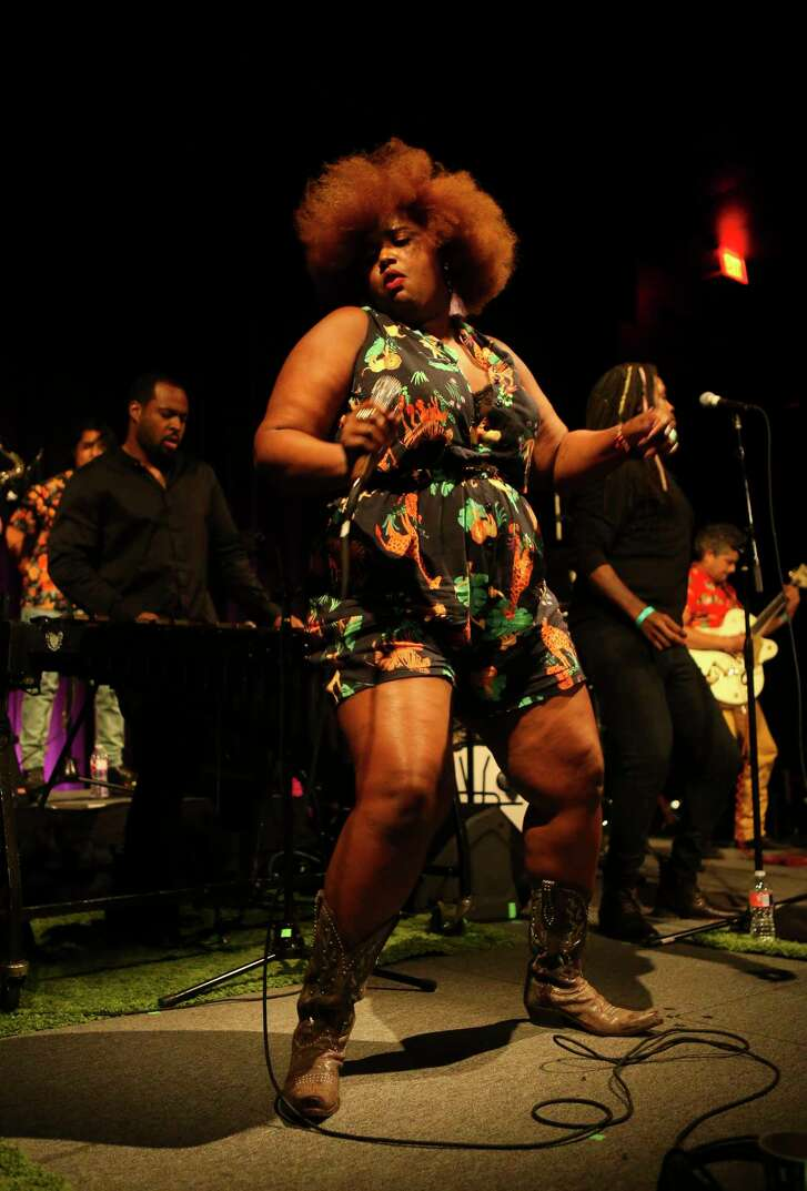 Kam Franklin leads The Suffers during their hometown album release show at The Heights Theater, Thursday, July 12, 2018.