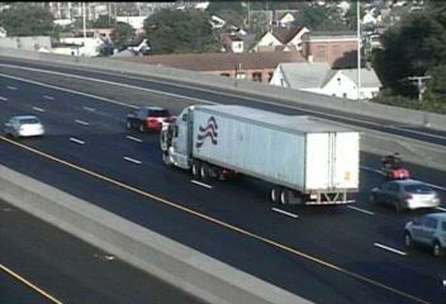 A disabled tractor-trailer is in one of the worst spots this time of day: Southbound I-95 in Bridgeport near Exit 27A on Friday, July 13, 2018. The truck has closed the center lane just as the morning commute begins to peak. Photo: /