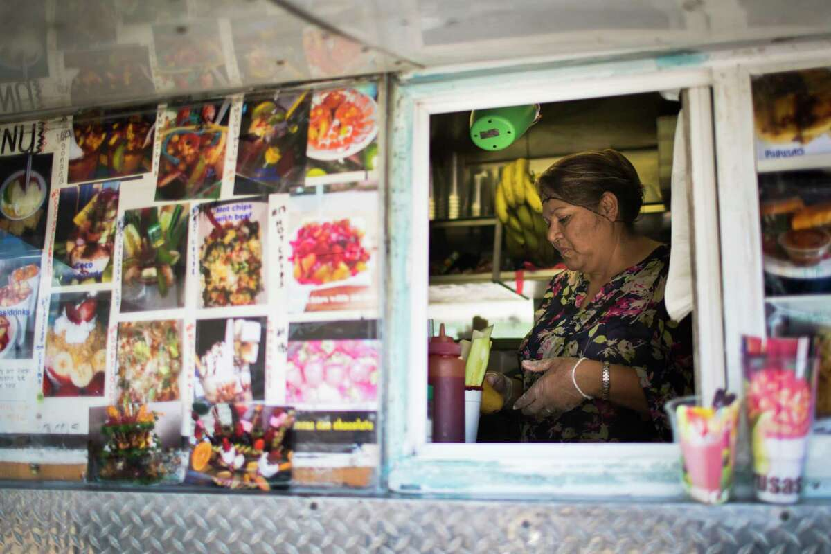 Ana Leticia Hernandez, 47, prepares a smoothy inside her food truck located in Houston, Friday, May 25, 2018. Hernandez has owned the small business for the past 22 years to be able to sustain her three children. Hernandez who is Salvadoran, is among the over 300,000 immigrants from different countries affected by President Donald Trump's administration suspension of their Temporary Protected Status (TPS).