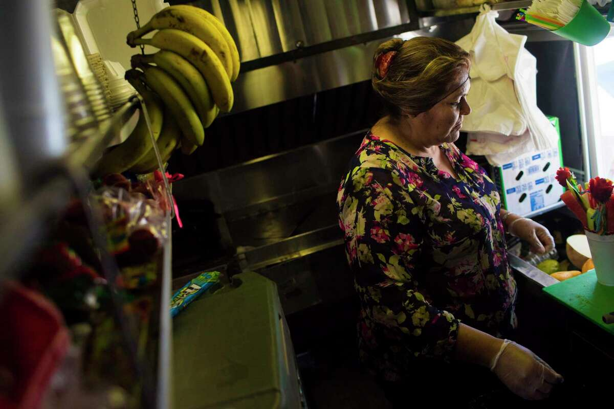 Ana Leticia Hernandez, 47, prepares a smoothy inside her food truck located in Houston, Friday, May 25, 2018. Hernandez has owned the small business for the past 22 years to be able to sustain her three children. Salvadoran Hernandez is among the over 300,000 immigrants from different countries affected by Trump's administration suspension of their Temporary Protected Status (TPS).