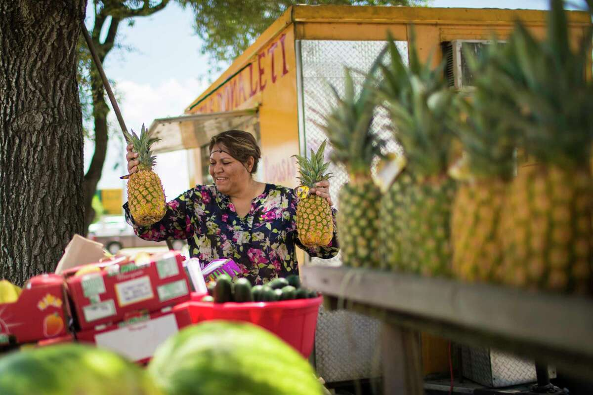 Ana Leticia Hernandez, 47, is a single mother who has a small business of fruit arrangements named