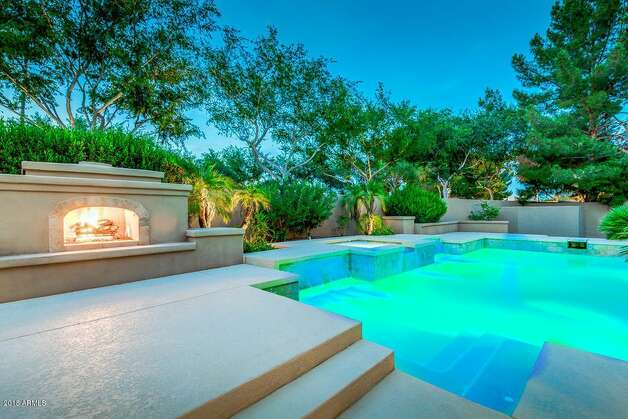 "Built in 2003, the sprawling luxury estate features six bedrooms, seven bathrooms, and nearly 6,000 square feet. Tyrann ""Honey Badger"" Mathieu bought the Santa Barbara-style home in 2017 for $1.23 million. Photo: Realtor.com"