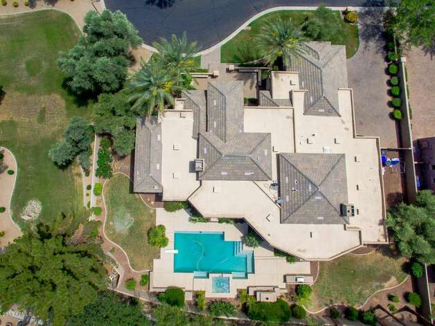 """Built in 2003, the sprawling luxury estate features six bedrooms, seven bathrooms, and nearly 6,000 square feet. Tyrann """"Honey Badger"""" Mathieu bought the Santa Barbara-style home in 2017 for $1.23 million. Photo: Realtor.com"""