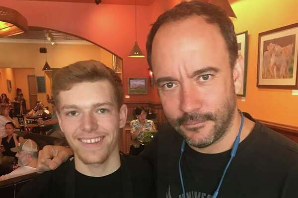 "Dave Matthews with Uncommon Grounds employee Ian ""Maui"" Chamberlaine in Saratoga Springs on Thursday, July 12, 2018."