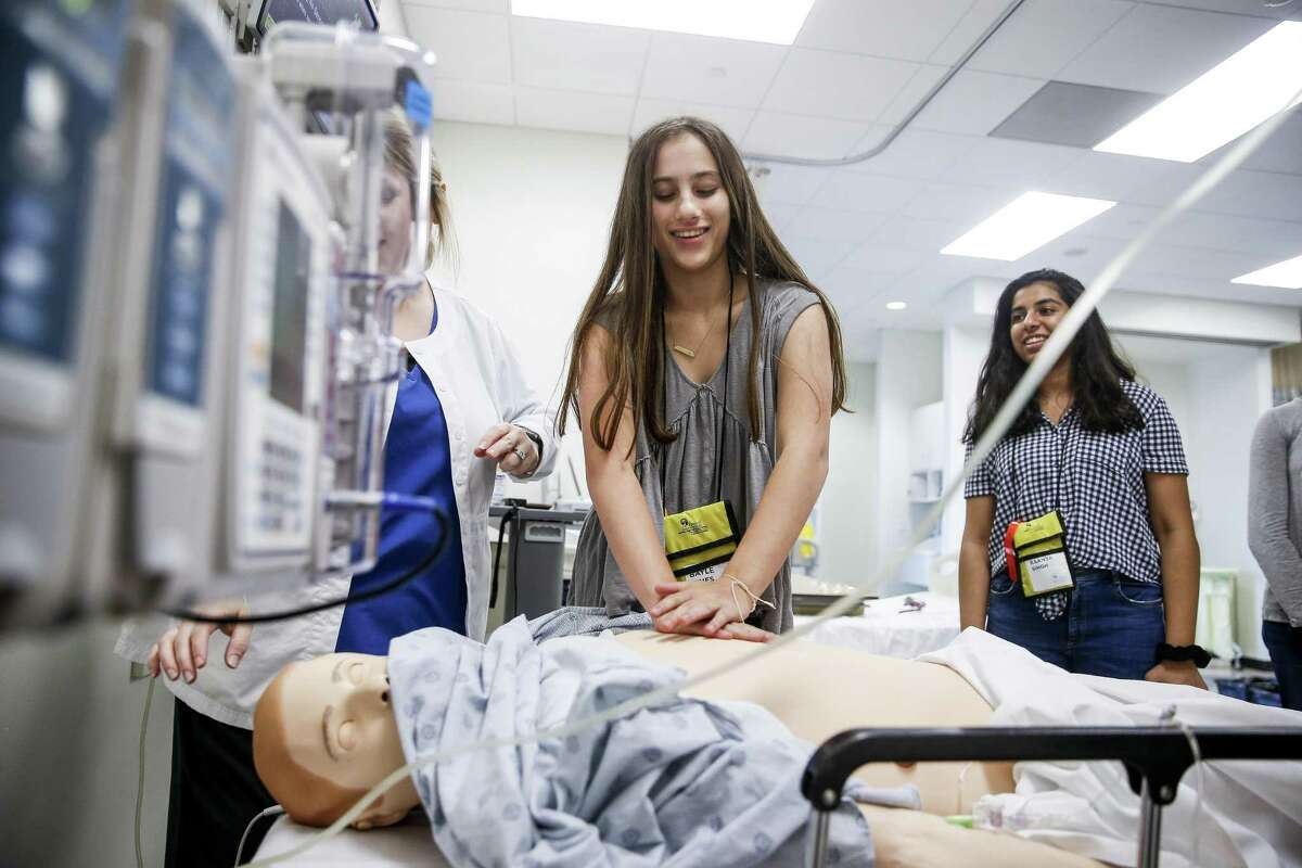 Bayle Vines works to perform CPR on a manikin at the Texas Woman's University simulation lab during the Faces of Innovation Global Teen Medical Summit hosted by the Health Museum July 10, 2018 in Houston. The teens spend a week learning about the medical field at facilities across the Texas Medical Center. (Michael Ciaglo / Houston Chronicle)