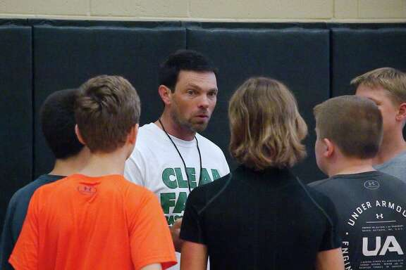 Clear Falls basketball coach Blake Joy speaks to campers Thursday during the Clear Falls summer basketball camp.