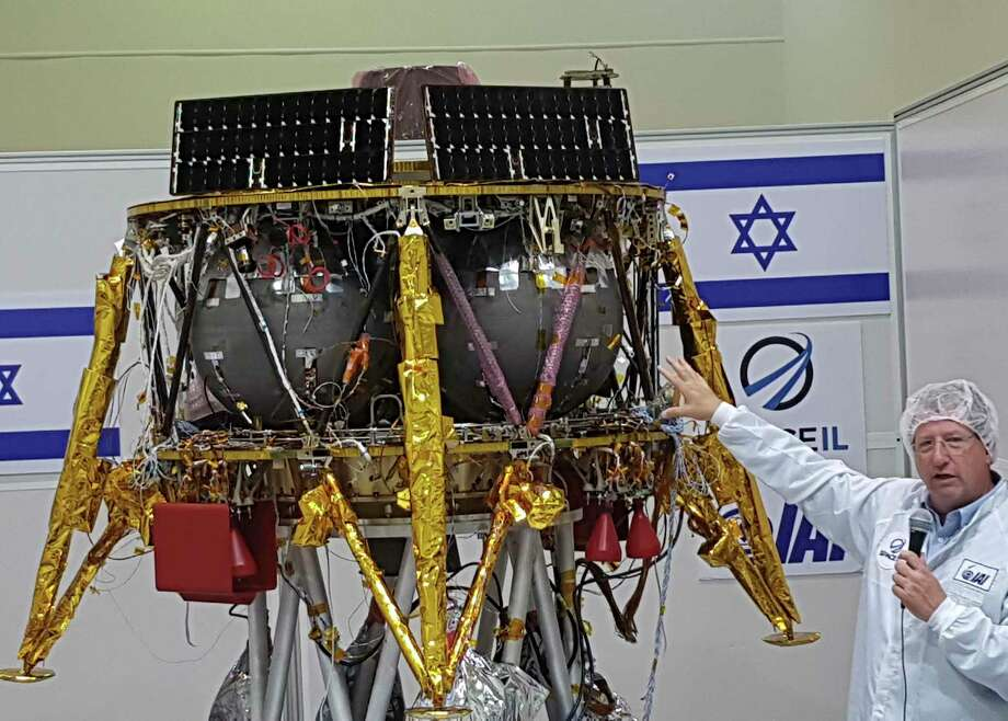 "Opher Doron, general manager of Israel Aerospace Industries' space division, speaks beside the SpaceIL lunar module, in a special ""clean room"" where the space craft is being developed, during a press tour of their facility near Tel Aviv, Israel, Tuesday, July 10, 2018. SpaceIL and the state-owned Israel Aerospace Industries plan to launch their unmanned craft in December hoping to become the first non-governmental entity to land a spacecraft on the moon. (AP Photo/Ilan Ben Zion) Photo: Ilan Ben Zion, Associated Press / Copyright 2018 The Associated Press. All rights reserved."