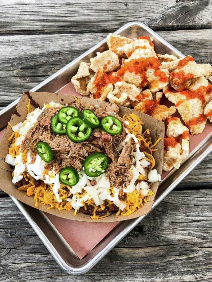 Frito pie at The Pit Room with an extra side of chicharrones Photo: J.C. Reid