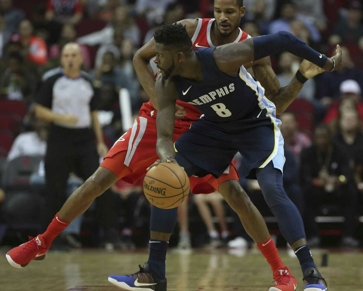 Houston Rockets forward Trevor Ariza (1) and Memphis Grizzlies forward James Ennis III (8) battle for a loose ball during the first quarter of an NBA game at Toyota Center on Saturday, Nov. 11, 2017, in Houston. ( Yi-Chin Lee / Houston Chronicle )