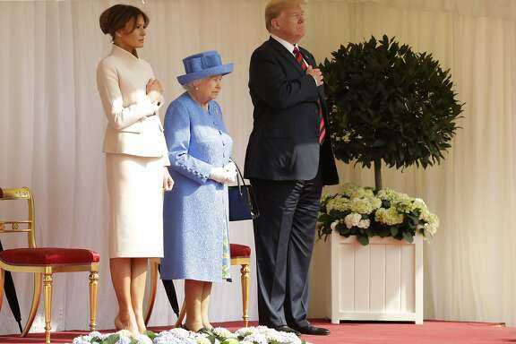 U.S. President Donald Trump and first lady Melania Trump stand with Britain's Queen Elizabeth II on the dais in the Quadrangle of Windsor Castle in Windsor, England, Friday, July 13, 2018.(AP Photo/Matt Dunham, Pool)