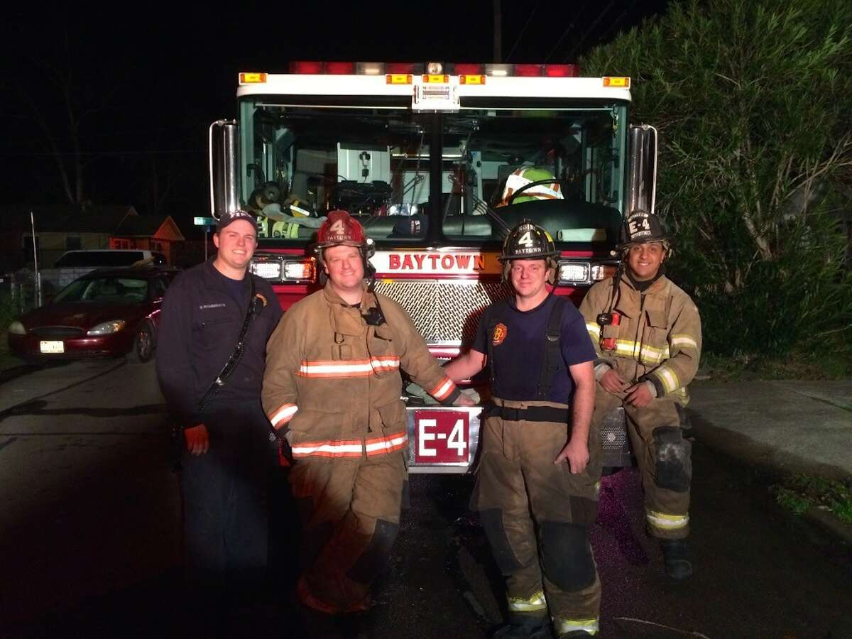 Baytown firefighter Patrick Mahoney (second from left) is being sued by the city of Baytown to deny him coverage for his cancer treatment.