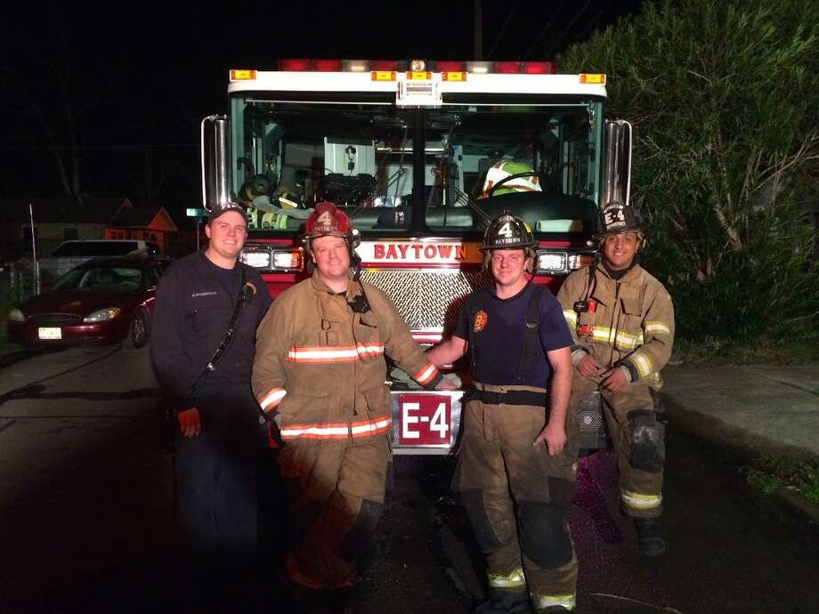 Baytown firefighter Patrick Mahoney (second from left) is being sued by the city of Baytown to deny him coverage for his cancer treatment. Photo: Baytown Fire Department