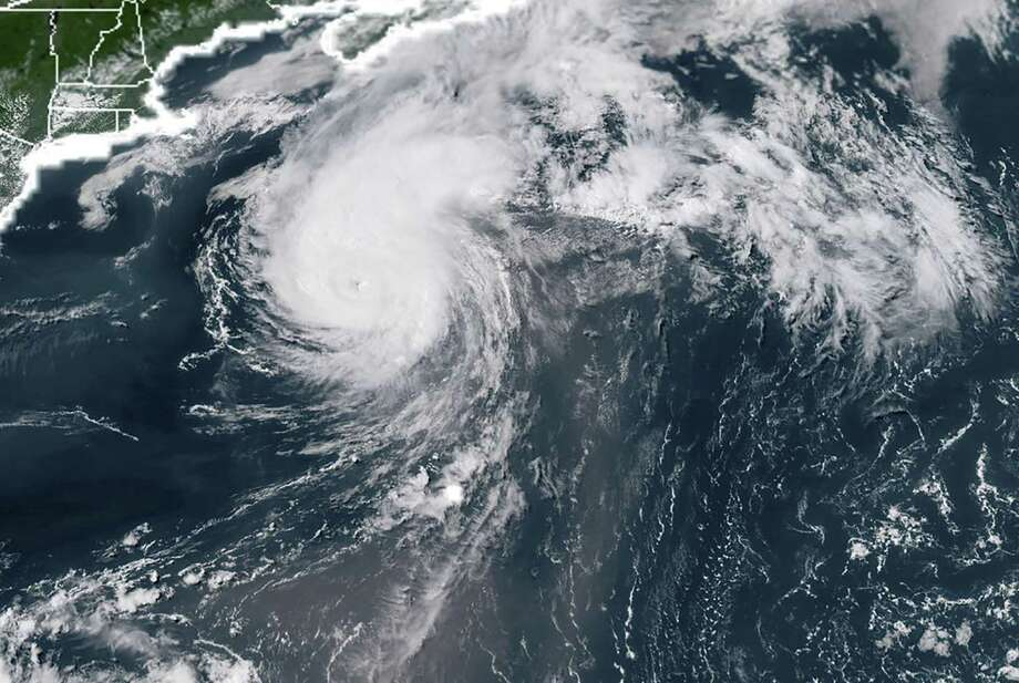 This NOAA/RAMMB satellite image on July 11, 2018 shows Hurricane Chris off the US East Coast. Tech is so crucial to the way we live now that it's important that you take steps in advance of hurricane to keep data safe and devices working in potentially dangerous situations. Photo: HANDOUT /AFP /Getty Images / AFP or licensors