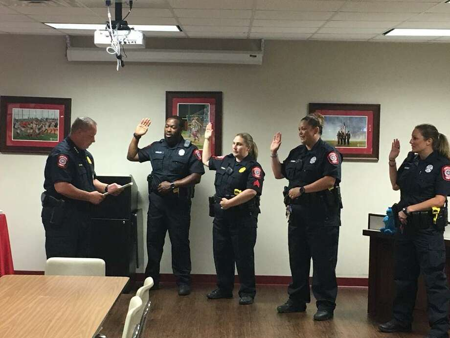 At the beginning of July, SISD Police Chief Rex Evans swore in four new police officers who will undergo new training as he works to revamp the district's police department. Photo: Courtesy Of Splendora ISD PD