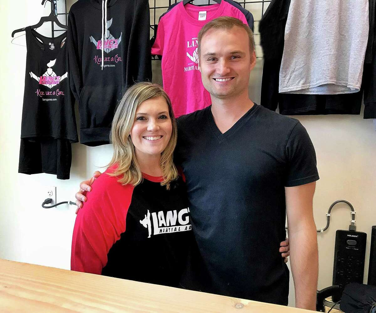 Joe and Teresa Lang of Lang's Martial Arts stand in their new studio in Brookfield, Conn., on Wednesday, July 11, 2018.