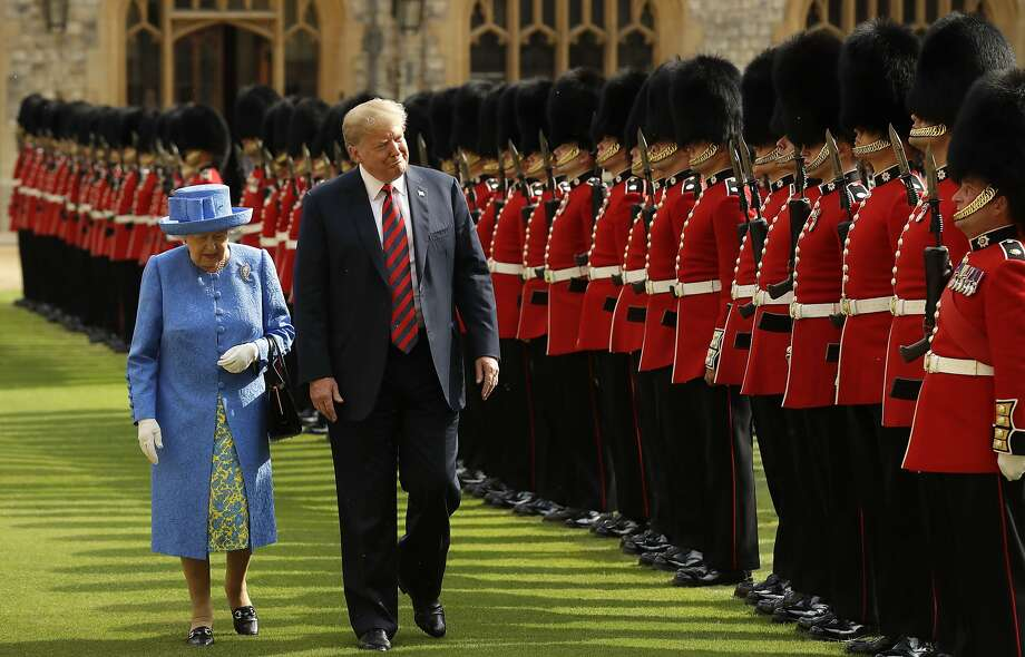 Queen Elizabeth II inspects the Guard of Honour, formed of the Coldstream Guards, with President of the United States, Donald Trump at Windsor Castle on July 13, 2018 in Windsor, England.  Her Majesty welcomed the President and Mrs Trump at the dais in the Quadrangle of the Castle. A Guard of Honour, formed of the Coldstream Guards, gave a Royal Salute and the US National Anthem was played. The Queen and the President inspected the Guard of Honour before watching the military march past. The President and First Lady then joined Her Majesty for tea at the Castle.  (Photo by Matt Dunham - WPA Pool/Getty Images) Photo: WPA Pool, Getty Images