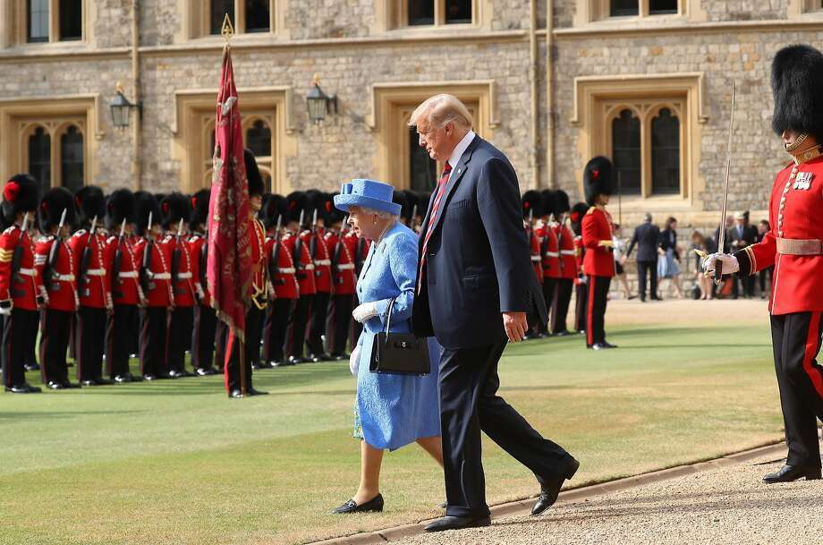 Queen Elizabeth II and President of the United States, Donald Trump inspect an honour guard at Windsor Castle on July 13, 2018 in Windsor, England.  Her Majesty welcomed the President and Mrs Trump at the dais in the Quadrangle of the Castle. A Guard of Honour, formed of the Coldstream Guards, gave a Royal Salute and the US National Anthem was played. The Queen and the President inspected the Guard of Honour before watching the military march past. The President and First Lady then joined Her Majesty for tea at the Castle.  (Photo by Chris Jackson/Getty Images) Photo: Chris Jackson, Getty Images